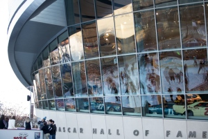 Reflections of ice skaters streatch across the windows at the Nascar Hall of Fame. Holiday on Ice is an annual event held around Christmas. (Joshua Komer for the Free Press)